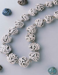 Use this simple process to begin making polymer clay beads and polymer clay projects.
