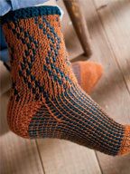 Follow the tapestry crochet tutorial in Interweave Crochet Fall 2012 to make these socks.