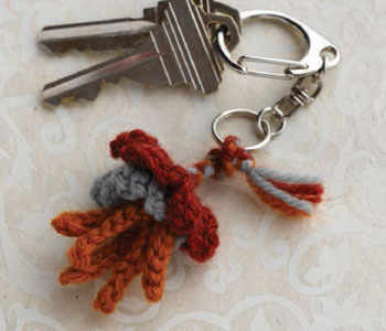 Crochet a flower for all uses, including as a key ring decoration like shown here