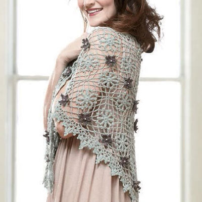 Crochet a flower for all uses, including for use on a beautiful shawl like shown here.