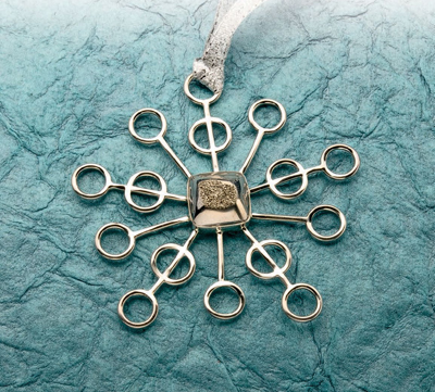 Learn how to make a silver snowflake pendant with this free tutorial!