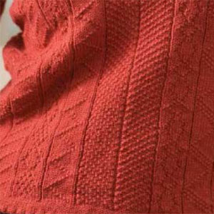 Learn how to knit a sweater with cables, ribs and more.