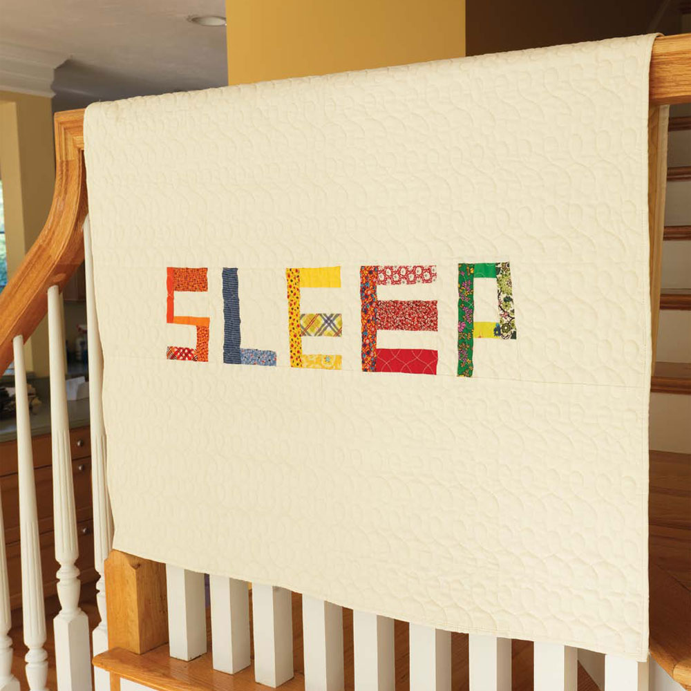 Get two baby quilt patterns for beginners in this collection, including this sleep quilt.
