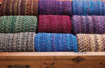 Discover all five homespun yarn free patterns to create stunning scarf designs.
