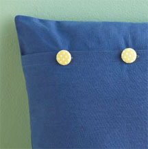 Use buttons to add flair to a simple envelope closure.
