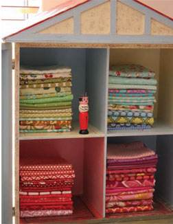 Lisa's childhood dollhouse keeps favorite fat quarters dust-free.