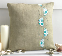 Modern Eyelet Pillow by Blair Stocker.