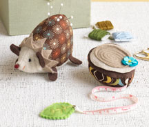 Hedgehog Pincushion and Tree-Stump Tape Measure by Heidi Boyd.
