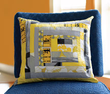 Asymmetrical Log Cabin Pillow by Lisa Congdon.