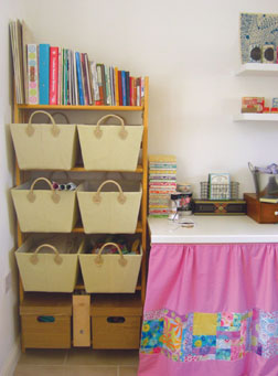 Lucie organizes her fabric and supplies and in open bins for easy access.