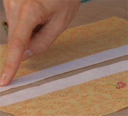 Add interfacing to seam allowances before sewing a zipper.